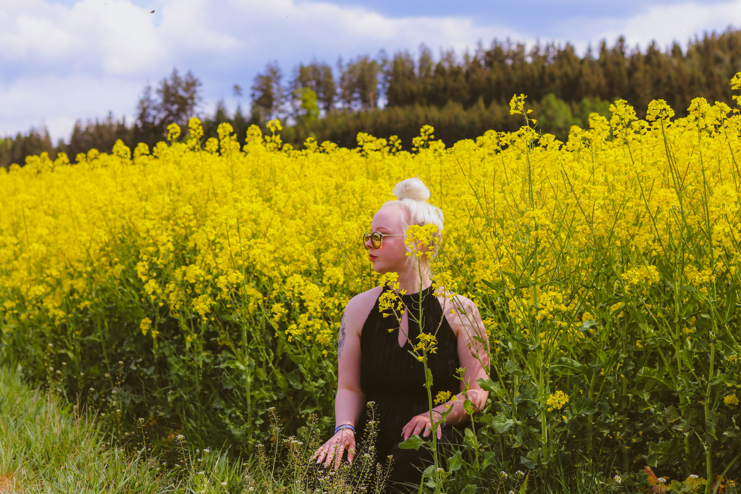 yellow, real people, plant, childhood, flowering plant, flower, child, land, field, girls, nature, lifestyles, growth, women, beauty in nature, females, leisure activity, one person, day, outdoors, innocence