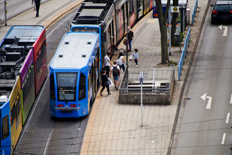 High Angle View Of People Walking On Footpath In City
