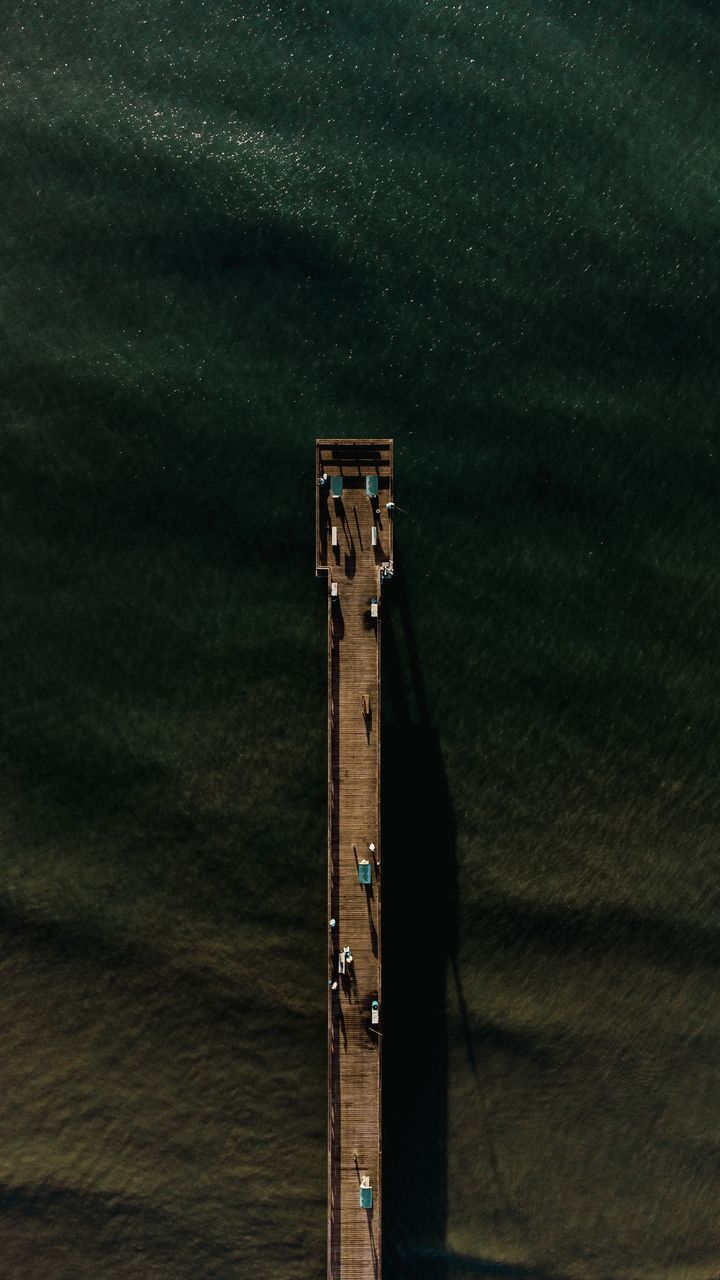 HIGH ANGLE VIEW OF TELEPHONE POLE ON BUILDING