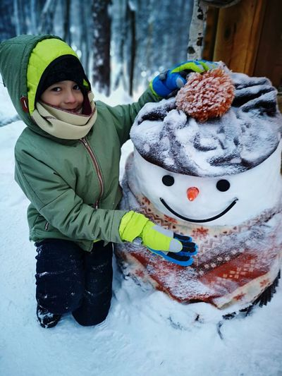 Do you wanna build a Snowman? Winter Wonderland Wintertime Winter Fun In The Snow Frozen Snow Man Boy Fun Warm Clothing Snowflake Snow Cold Temperature Portrait Snowing Child Childhood Winter Smiling Winter Coat Scarf