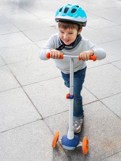 Boy riding toy car