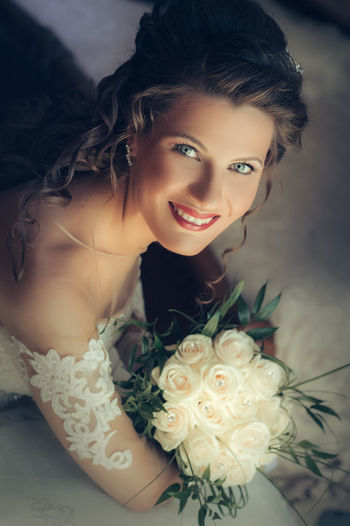 High Angle Portrait Of Happy Beautiful Bride With Hand On Chin At Home