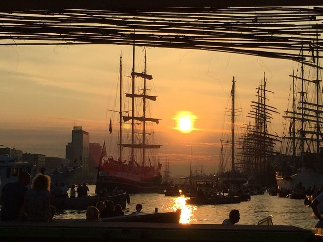The nautical event every 5 years: Amsterdam Sail. This picture was taken at the 2015-edition. The beautiful sight of the tallships bading in the orange light of sunset. Amsterdam Harbour Tall Ship nautical vessel orange color sail sailamsterdam2015 ship sunset Amsterdam Harbour Sail Sail2015 Ships Sky Sunlight Sunset Tallships Water