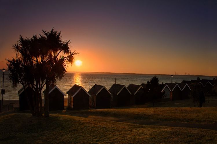 Beach Huts at Sunset Sky Sunset Water Sea Tree Plant Beauty In Nature Beach Scenics - Nature