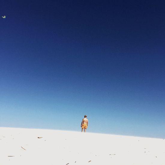 Low angle view of man against blue sky at plaza karwienskie blota