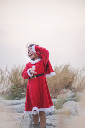 Little girl in Santa dress... at Sea side. Santy  Santa Santa Claus Stone Rock - Object Sea Sea Side Seascape Holiday Girl Little Girl Kid Dress Thailand Asian  Sattahip Chonburi ,Thailand Grass Red Hat Reindeer Smile Happiness One Person Clothing Standing Nature Day Leisure Activity Full Length Childhood Young Adult Water Child Holding Winter Looking Front View Lifestyles Outdoors Warm Clothing Innocence
