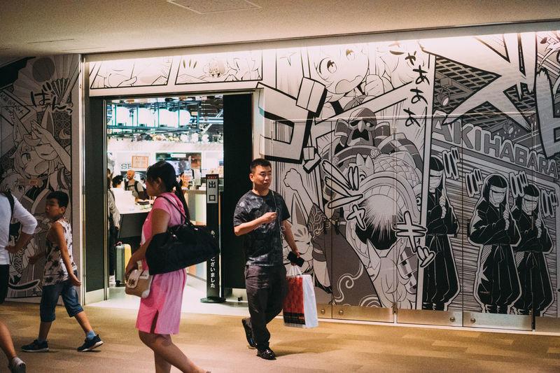People in graffiti on wall