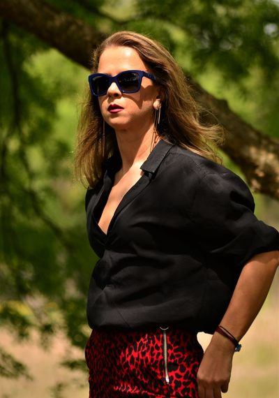 Beautiful woman wearing sunglasses while standing outdoors