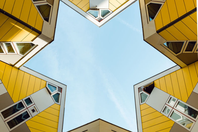 Low angle view of yellow buildings against sky