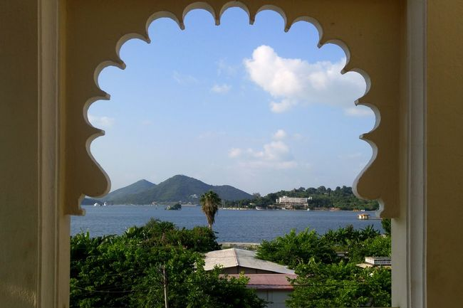 Tree Sky City Cloud - Sky Day Indoors  Nature View From My Hotel Room Incredible India City Of Lakes Travel Destinations Relaxation Soothing Udaipur LoveNature Scenicview Palatial Living Life Room Window Architecture Close-up Lake View Mountains Greenery Open Window