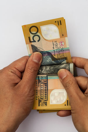 Male hands counting Australian $50 dollar notes Australia Australian Budget Currency Economy Fiscal Investing In Quality Of Life Rate Salary Super Bank Banking Cash Finance Financial Fund Invest Monetary Money Notes Rates Retirement Saving Tax Wealth