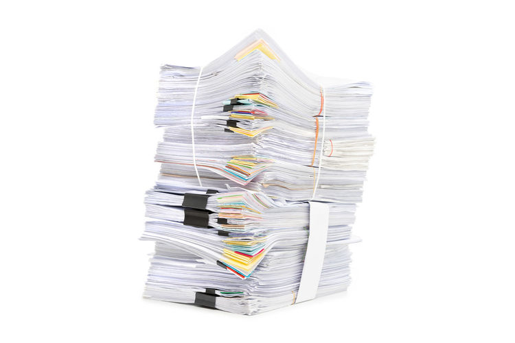Close-up of paper stack against white background