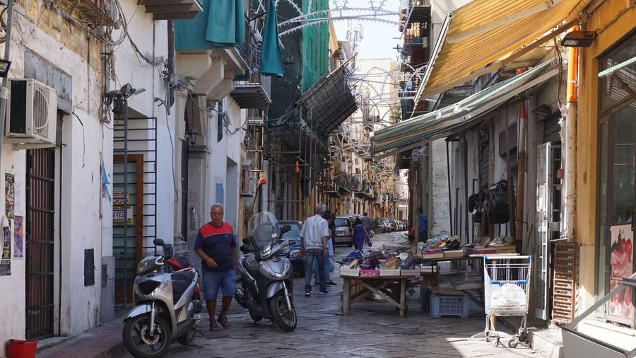 street scene in an alley in Palermo, Sicily, Italy Alley Palermo Travel Destinations Scooter Street Real People Incidental People Shoes Store Sicily