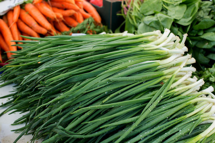 Fresh scallions at market stall