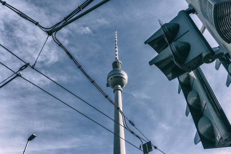 TV Tower with traffic lights and electrical cables Architecture Berlin Germany 🇩🇪 Deutschland Horizontal Architecture Building Exterior Built Structure City Cloud - Sky Color Image Communication Day Low Angle View No People Outdoors Sky Spire  Tall - High Television Tower Tower Travel Travel Destinations