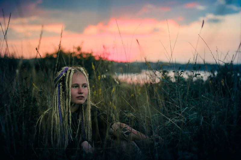 Beautiful Woman Beauty In Nature Cloud - Sky Contemplation Field Front View Grass Growth Hairstyle Land Leisure Activity Lifestyles Nature One Person Outdoors Plant Portrait Real People Sky Sunset Women Young Adult Young Women The Photojournalist - 2018 EyeEm Awards The Great Outdoors - 2018 EyeEm Awards