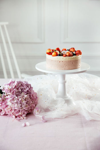 Cake And Flowers On Table During Celebration
