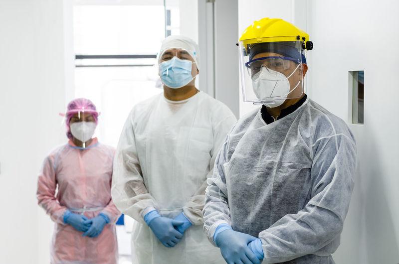 Doctors wearing mask standing in hospital