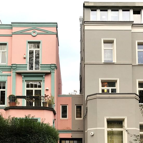 Architecture Symmetry Building Exterior Colors Pink Grey Pastel Contrast Built Structure Window Outdoors Residential Building Low Angle View Day Balcony No People Sky City Air Conditioner Lines Windows