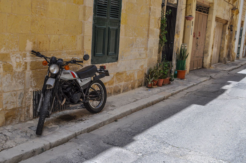 A vintage enduro motorcycle in the streets of Birgu, Vittoriosa, Malta. 1980s Style 3 Cities Malta Malta Retro Building City Day Enduro Endurobike Footpath Mode Of Transportation Motor Scooter Motorbike Motorcycle No People Residential District Road Scooter Street Street Photography Street Scene Transportation Vintage Yamaha