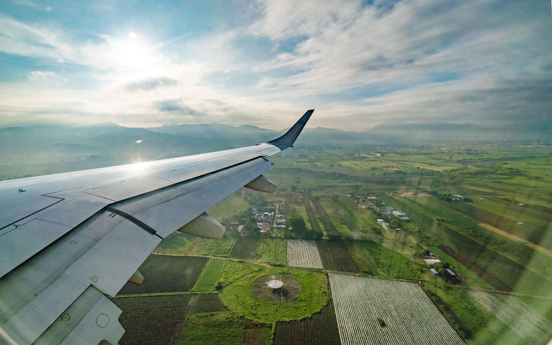 Foreign Farmland Agriculture Aircraft Wing Airplane Arial View Cloud - Sky Day Farming Flying Landscape Outdoors Sky Tourism Transportation Travel