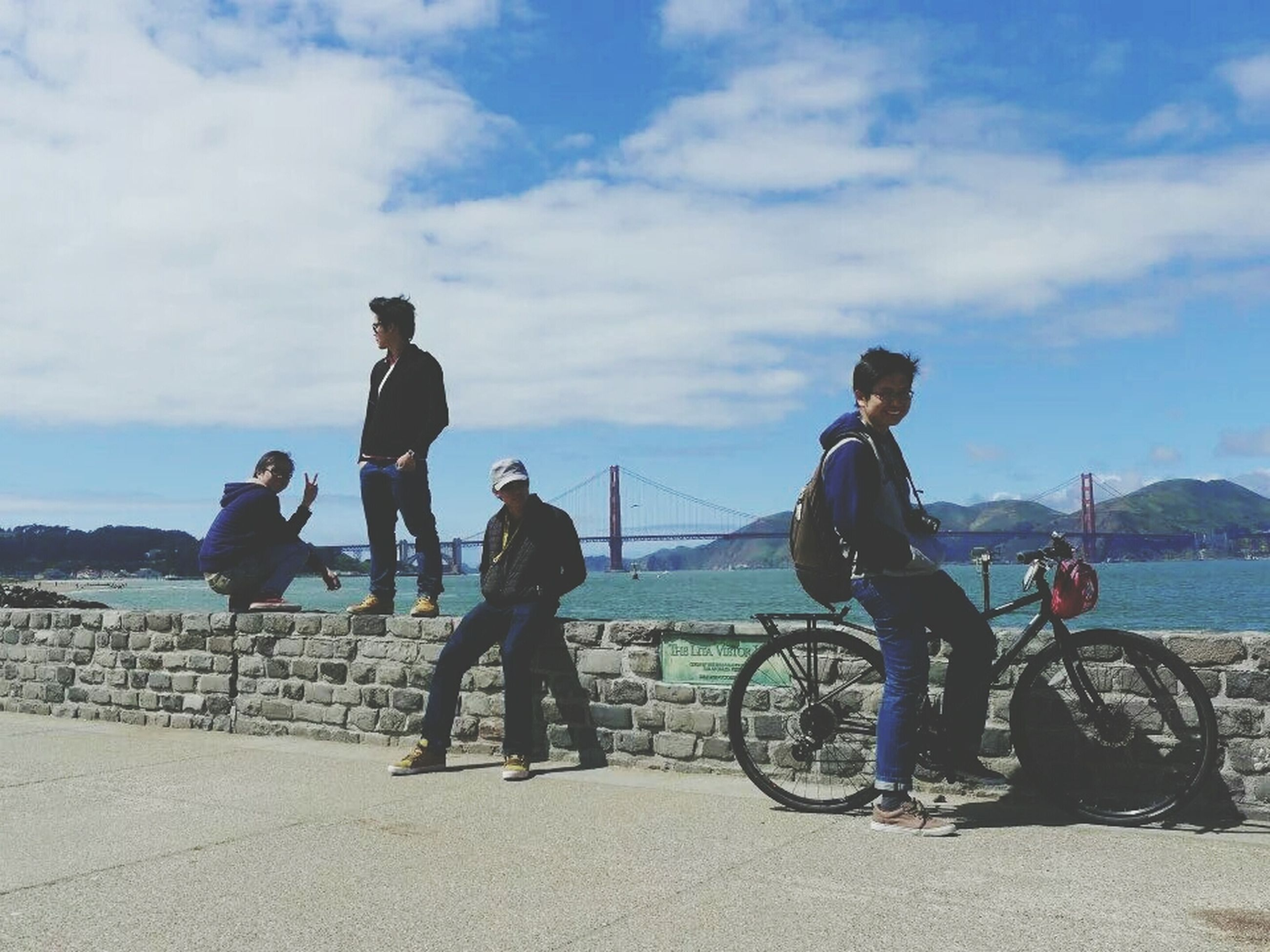 lifestyles, men, leisure activity, sky, water, full length, transportation, sea, casual clothing, togetherness, cloud - sky, mode of transport, day, nautical vessel, boys, person, standing, rear view