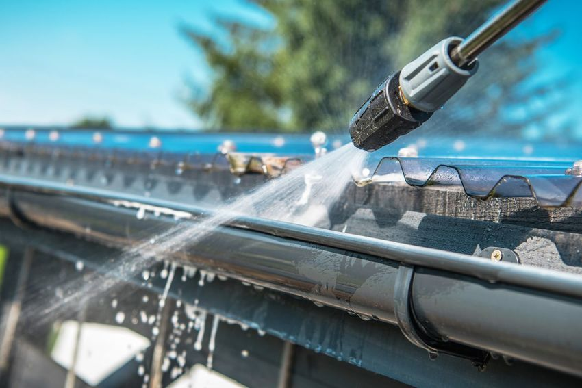 Spring Rain Gutters Cleaning Using Pressure Washer. Closeup Photo. Cleaner Cleaning Industry Washing Architecture Glass - Material Motion Pressure Washer Rain Gutter Transparent Water