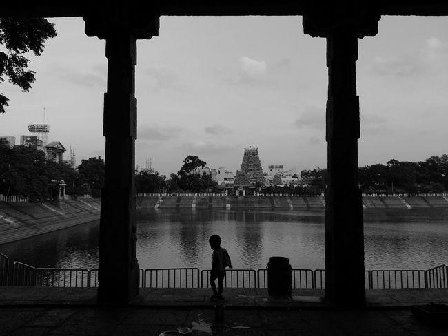 Chennai,India Mylapore Temple Tank Foreground Pillars Child In Silhouette Black And White Light And Dark