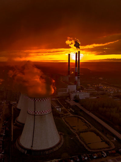 World of Warm sunsets. Aerial Minsk City view Building Exterior Architecture Factory Sky Industry Cloud - Sky Built Structure Sunset Smoke Stack No People Pollution Nature City Fuel And Power Generation Outdoors Cityscape Environment High Angle View Air Pollution Transportation Minsk Belarus Aerial View Aerial Power Plant