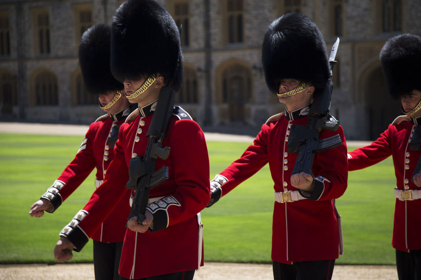 EyeEmNewHere Buckingham Palace Castle Queen United Kingdom Architecture Costume Day Focus On Foreground Outdoors People Queens Guard Real People Red Royal Royal Guard Royal Guards Standing Togetherness Uniform