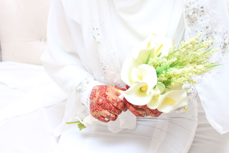 The bride holds a flower Bouquet Bride Bridegroom Close-up Day Flower Food Food And Drink Freshness Groom Indoors  Life Events Midsection One Person Ready-to-eat Real People Wedding Wedding Dress White Color