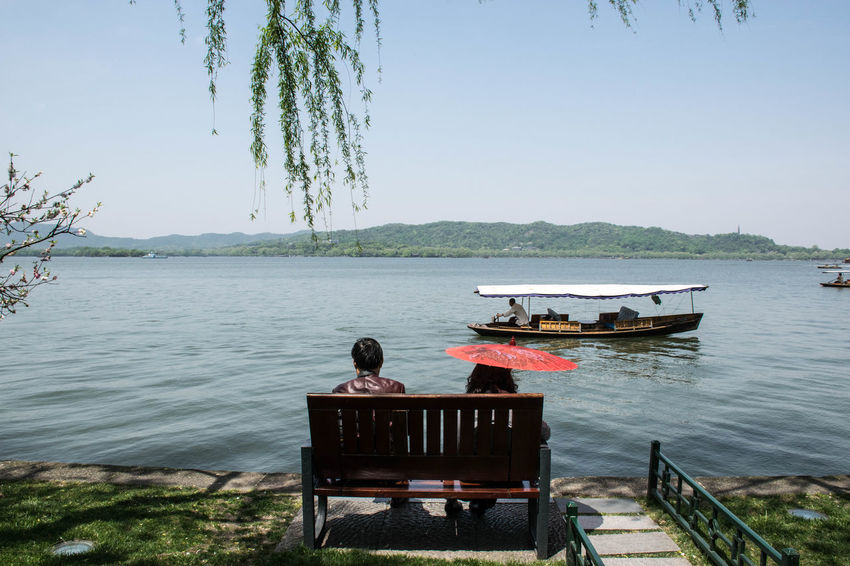 Hanging out in China Connected By Travel Beauty In Nature Lake Nature Outdoors Real People Scenics Sitting Tree Water Be. Ready.