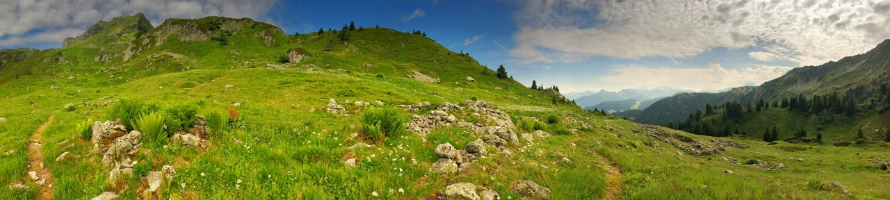 Panorama Scenics - Nature Mountain Panoramic Landscape Sky Environment Plant Nature Grass Beauty In Nature Mountain Range Cloud - Sky Land Valley No People Green Color Day Outdoors Travel Destinations Mountain Peak Rolling Landscape