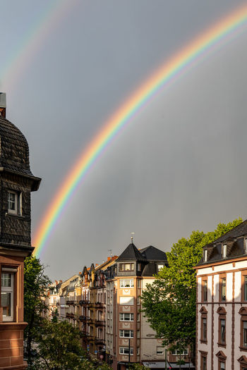 Rainbow over buildings in city