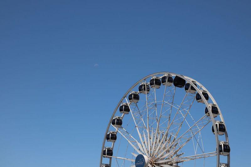 Moon Waterfront EyeEm Selects Sky Amusement Park Ride Amusement Park Clear Sky Arts Culture And Entertainment Ferris Wheel Blue Outdoors Circle Geometric Shape Architecture Sunlight Built Structure