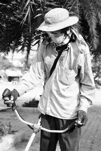 Man wearing hat working outdoors