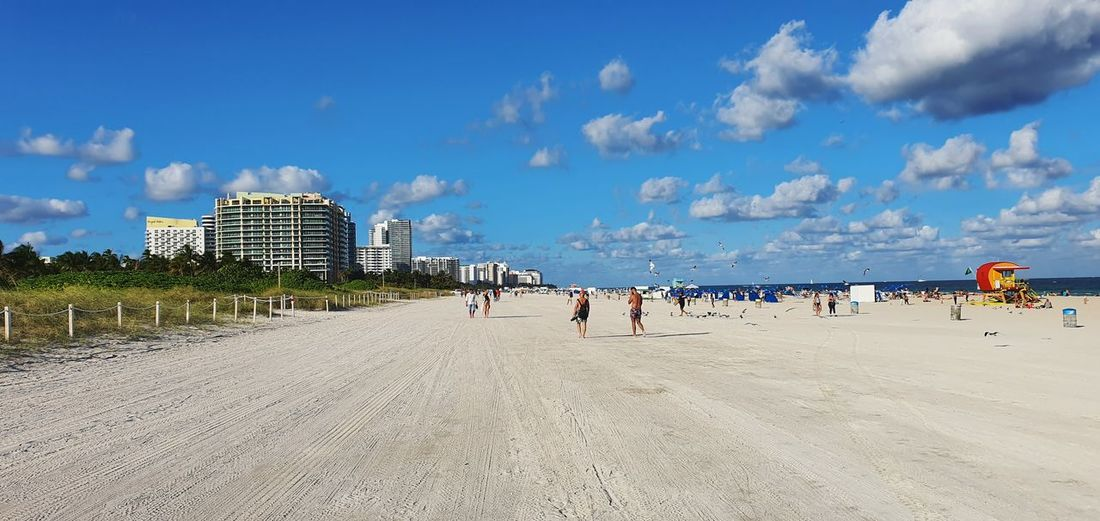 Panoramic view of beach against sky in city