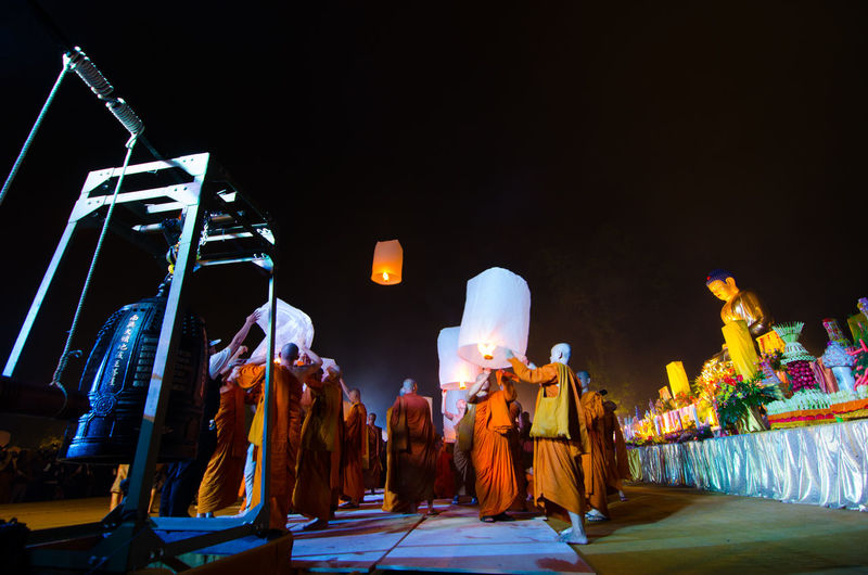 15 may 2014, Magelang, Indonesia : Participants releasing lanterns over the Borobudur temple in Magelang, Central Java during Vesak/Waisak Day celebrations Architecture Art And Craft Arts Culture And Entertainment Belief Built Structure Group Of People Human Representation Illuminated Light Lighting Equipment Night Real People Religion Representation Sculpture Spirituality Stage Stage - Performance Space