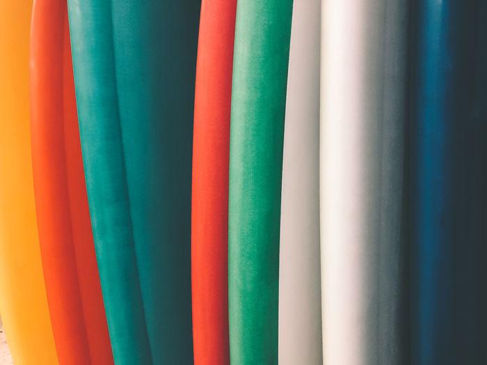 Full frame shot of multi colored surfboards