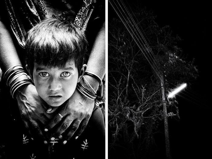 Full length portrait of boy in park at night