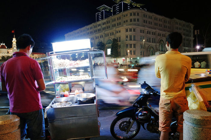 Adults Only Architecture Back Shot  Building Exterior Built Structure City Life Ho Chi Minh City Land Vehicle Long Exposure Shot Men Mobile Vendor Mode Of Transport Motobike Nguyen Hue St Night Photography Outdoors People Real People Rear View Saigon Night Street Food