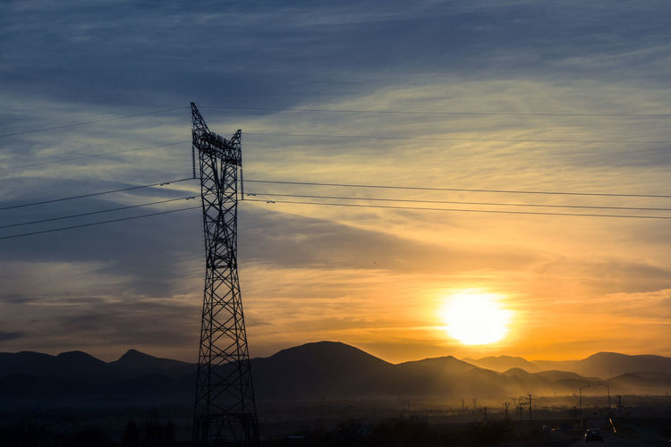 Beauty In Nature Cable Cloud Cloud - Sky Electricity Pylon Idyllic Landscape Majestic Mountain Mountain Range Nature No People Non-urban Scene Orange Color Outdoors Power Line  Power Supply Scenics Sky Sun Sunset Tranquil Scene Tranquility
