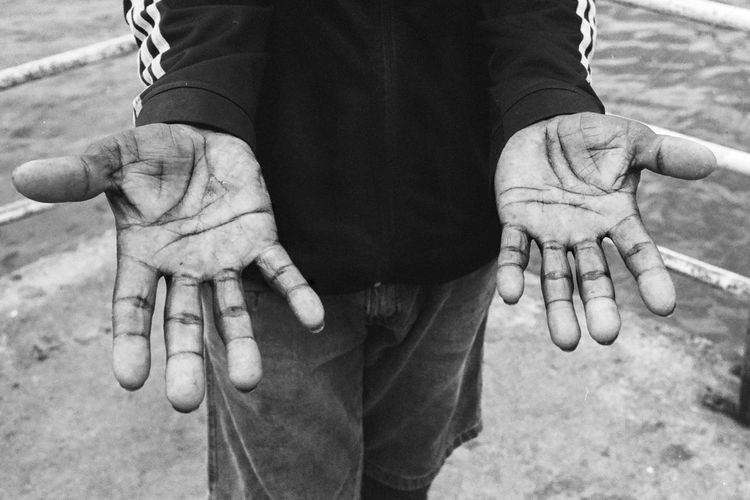Close-up of man hands outstretched