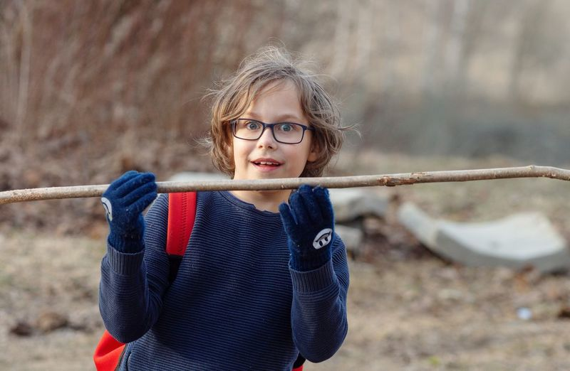 Stick Boy Playing Spring Eyeglasses  Elementary Age Casual Clothing Boys Will Be Boys!  Spear Javelin Child Childhood Front View Posing Outdoor Play Equipment Children Caucasian