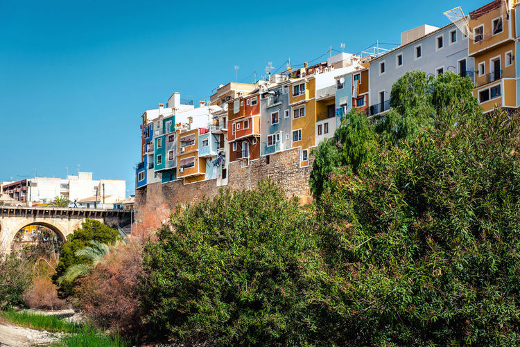 Multicolored town of Villajoyosa / La Vila Joiosa. Coastal town of Costa Blanca. Province of Alicante, Valencian Community, Spain Alicante, Spain Blue Sky Colorful Costa Blanca Famous Place Houses La Vila Joiosa Landscape Multi Colored Picturesque Village Residential Building Scenery Skyline South SPAIN Street Sunny Day Tourist Resort Town Travel Destinations Trees Tropical Climate Typical Houses Urban Landscape Villajoyosa