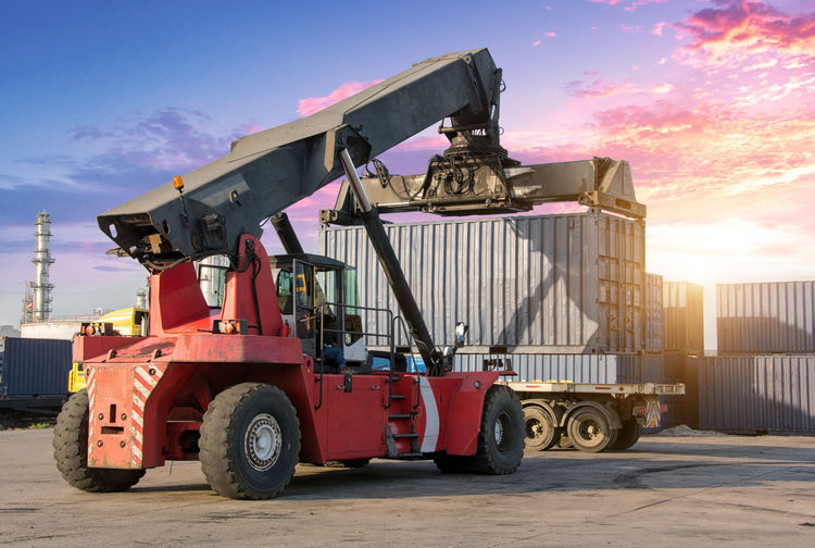 Crane Loading Cargo Container At Dock
