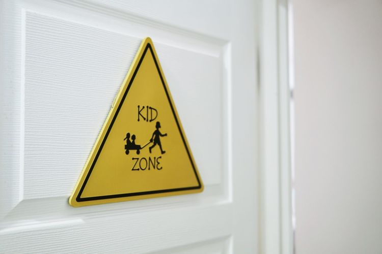 Close-up of warning sign on door