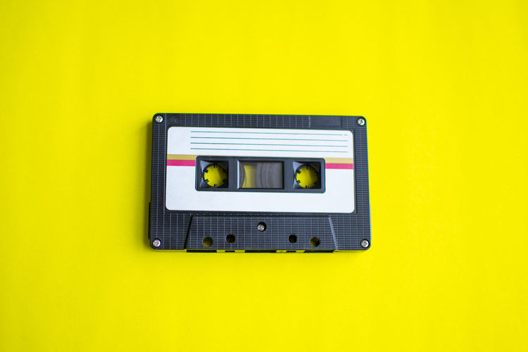 Tape Cassette Retro Old Vintage Yellow Technology No People Colored Background Indoors  Wall - Building Feature Close-up Studio Shot Single Object Copy Space Yellow Background Architecture Fuel And Power Generation Electricity  Green Color Control The Past Directly Above Connection Communication Power Supply