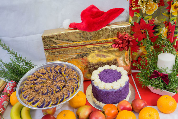 Close-Up Of Food And Gifts On Table During Christmas