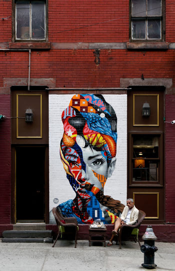 Audrey stood him up Streetwise Photography Architecture Built Structure Building Exterior Art And Craft Creativity Door Entrance Day Building Representation Outdoors Multi Colored Wall - Building Feature Window Human Representation Wall Graffiti City Brick Mural Waiting
